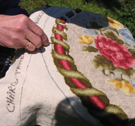 Loops of cloth or wool are hooked through backing meshe.