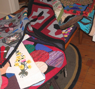 A selection of hooked rugs in the boutique.