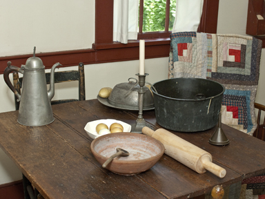 Kitchen table in Cossit House Museum