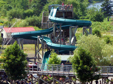 Whirl and twirl down 230 feet of wet water slide fun!